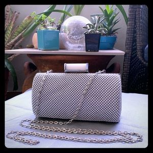 Small, textured silver clutch w shoulder strap